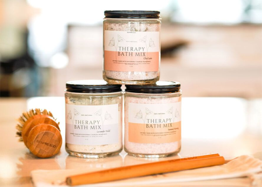 Collection of stacked bath therapy mixes, a bamboo scrubber brush and bamboo straws