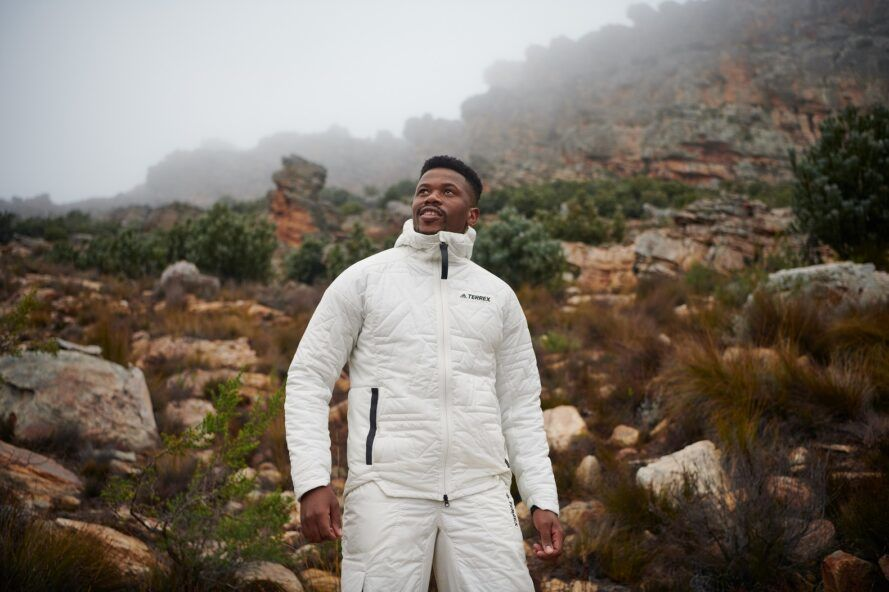 A man standing wearing a white puff jacket