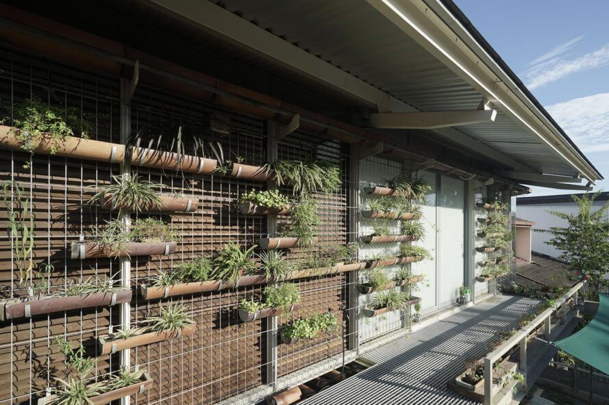 The side of a home with greenery embedded into the facade.