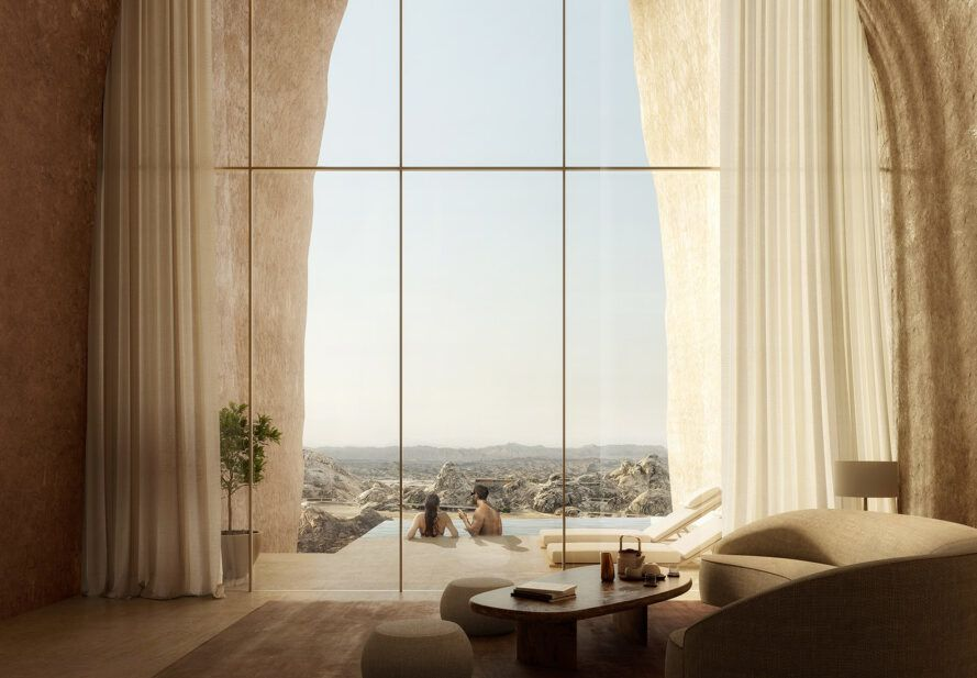 A bright room with a high ceiling and glass wall.