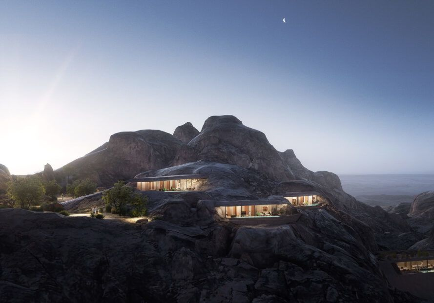 A lit-up structure built into a mountain.