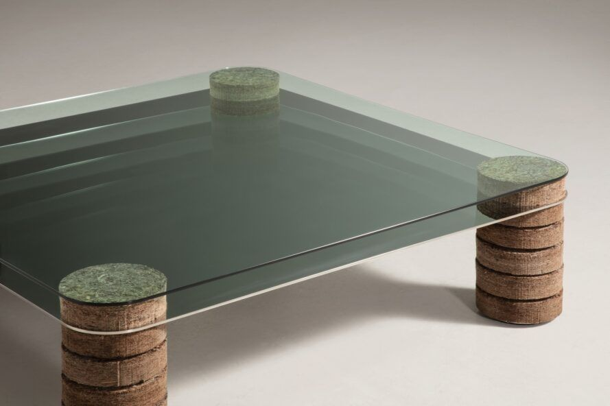 Glass table with legs made out of plant-based materials