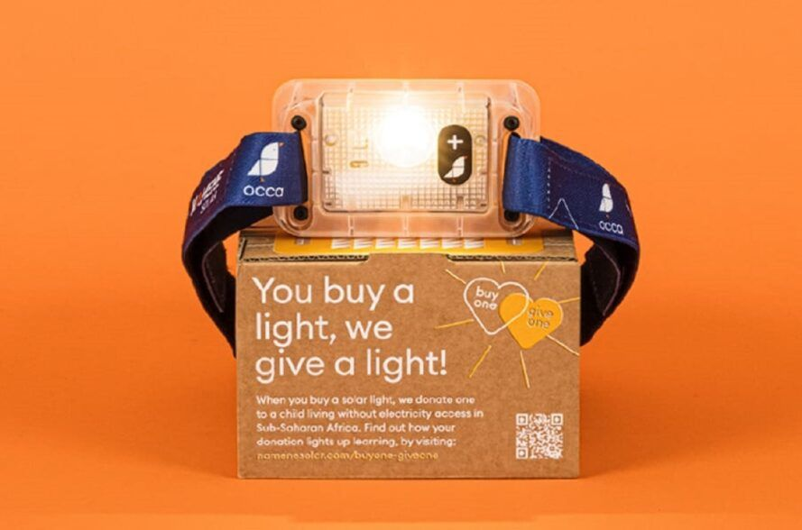 """Lamp on box that says """"you buy a light, we give a light"""""""