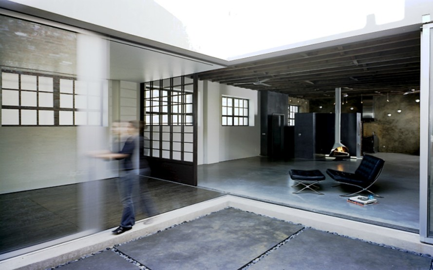 Former printing house converted into industrial-chic residence with unique inner courtyard