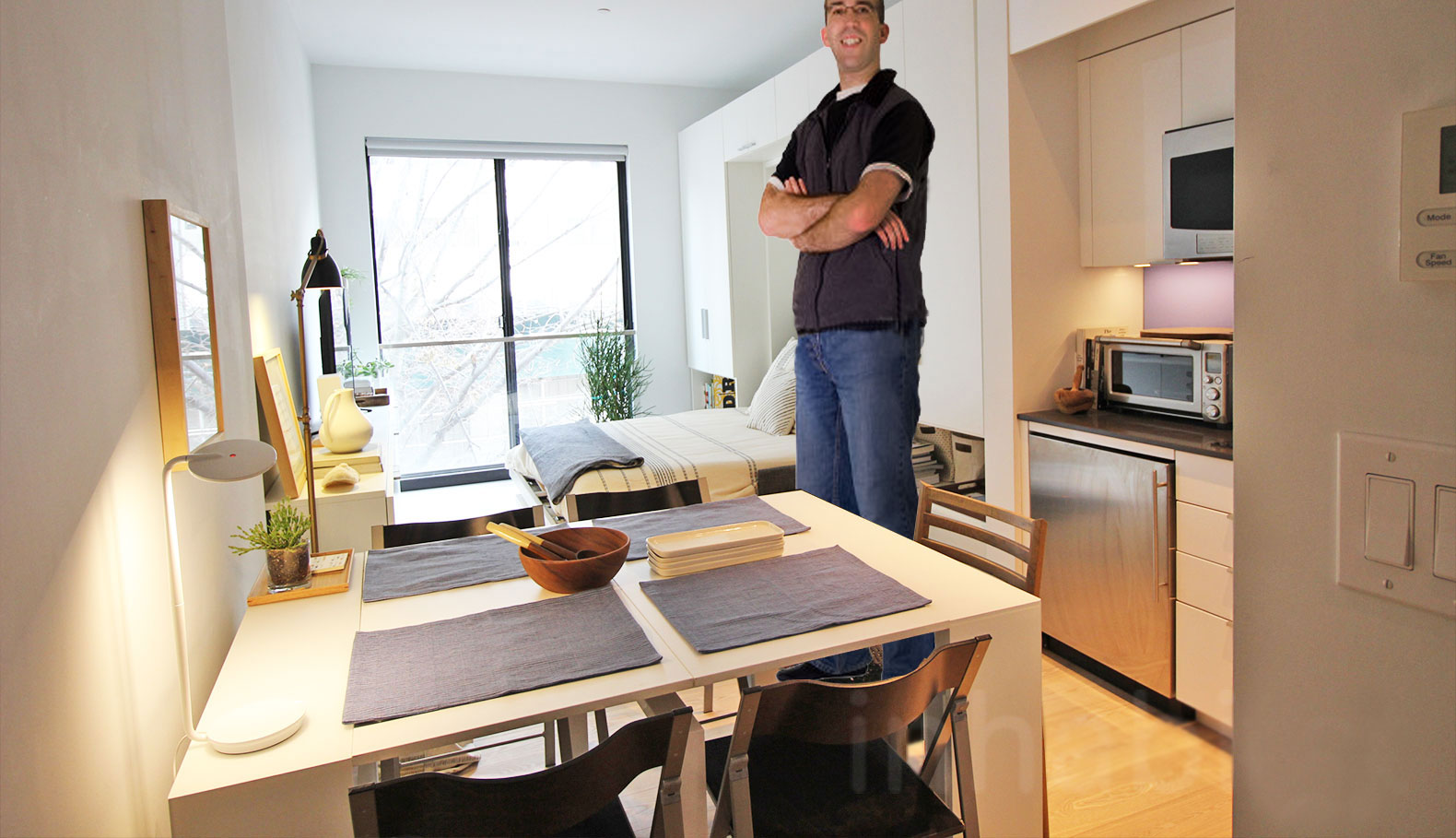 America's tallest man moves into NYC's first micro apartment building