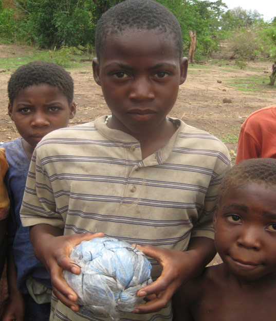 Toys For Poor : Kids in malawi make their own toys out of junk inhabitots