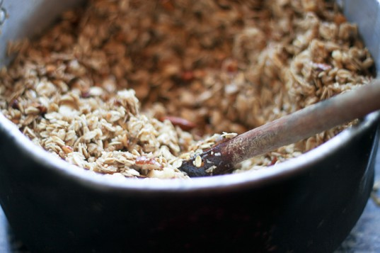 making granola, mixing ingredients, dry ingredients, wet ingredients, oatmeal, nuts, granola