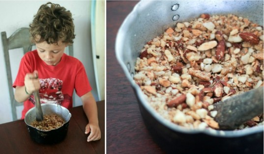 kid helping, kid cooking, child cooking, whole nuts, chopped nuts, mortar