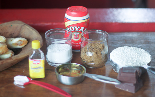 ingredients for cooking, banana bread ingredients, sugar, brown sugar, vanilla extract, oil, flour, chocolate