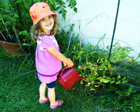 Olivia watering plants in her garden, if mom had three minutes, mom tips