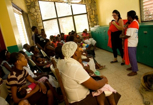 rockin baby, haiti mothers, rockin baby slings, mother to mother, teaching haitian women how to use slings