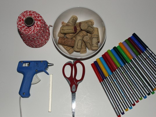 Step 1: Gather Your Supplies What you will need: 20 corks eco-friendly markers baker's twine scissors hot glue