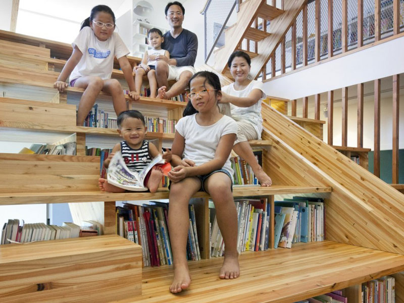Family Home's Library Slide Lets Kids Slip Right Into a Good Book