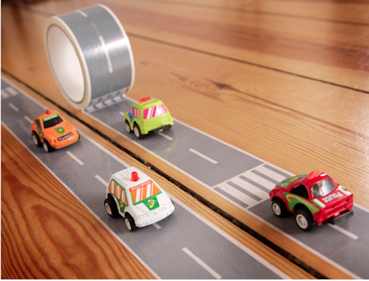 Tape Gallery's railroad tracks and road tape rolls transport kids to playtime anywhere