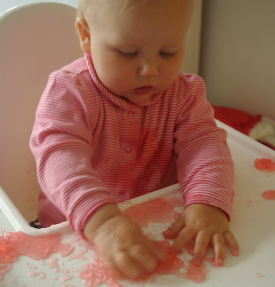 messy play ideas for babies, messy play, green baby, fun, baby learning, jello play, water play for babies, sensory spaghetti play, sensory play with beans beans