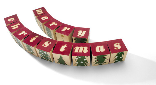 Merry Christmas blocks spell holiday greetings or stack up as ...