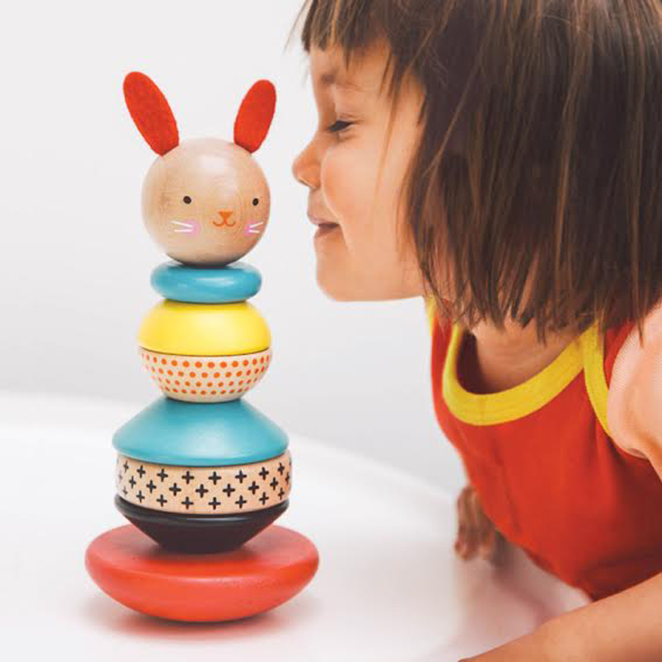 Petit collage inhabitots petit collages modern bunny wooden stacking toy hops into the playroom gumiabroncs Choice Image