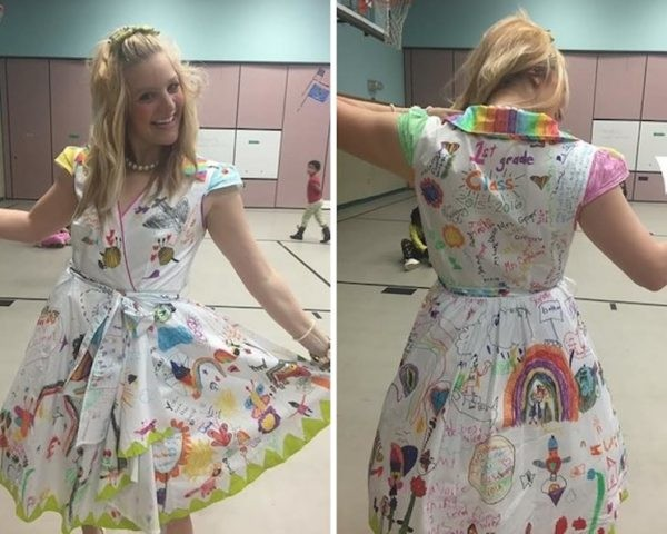 d0a1dcb0c8 First grade teacher proudly wears dress decorated by her students to  commemorate the end of the school year