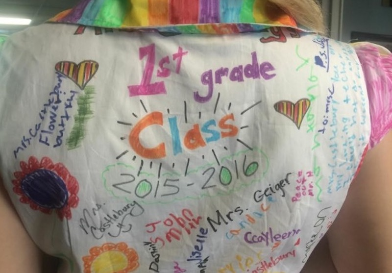 921d85c812 First grade teacher proudly wears dress decorated by her students to ...