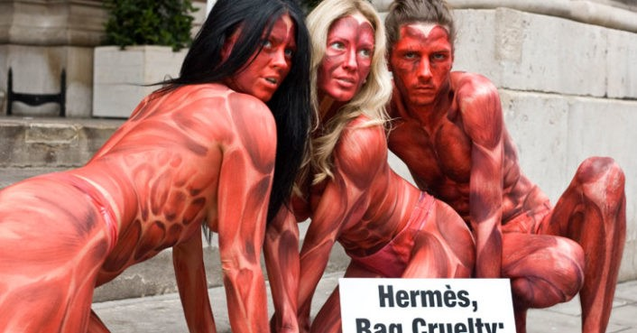 """Skinned"" PETA Activists Protest Outside Herm�s Leather Exhibition"