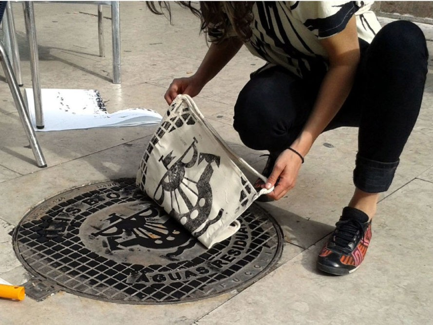 a0ec4097 Berlin Artists Use Manhole Covers, Utility Grates to Relief-Print Textiles